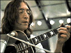 John Lennon Plays Guitar During The Recording Of Beatles Let It Be Album