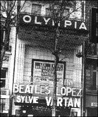 The marque of the Olympia Theatre in Paris, France. It announces the appearance of The Beatles and others on the bill; Trini Lopez and Sylvie Vartan. The Fab Four played at this venue just prior to going to America in February 1964 to appear on The Ed Sullivan Show.